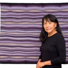 DY Begay with her weaving Confluence of Lavender © Kelso Meyer 2016